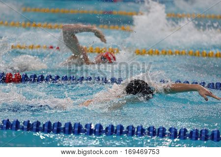 ST. PETERSBURG, RUSSIA - DECEMBER 16, 2016: Athletes compete in 200 m medley swimming competition during X Salnikov Cup. Athletes from 6 countries participated in the competitions