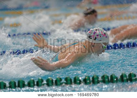 ST. PETERSBURG, RUSSIA - DECEMBER 16, 2016: Women compete in 100 m butterfly swimming competition during X Salnikov Cup. Athletes from 6 countries participated in the competitions