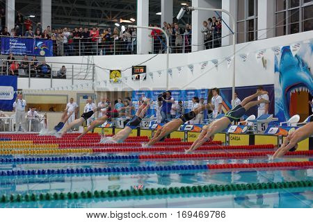 ST. PETERSBURG, RUSSIA - DECEMBER 16, 2016: Start of individual medley swimming competition on 200 m during X Vladimir Salnikov Cup. Athletes from 6 countries participated in the competitions