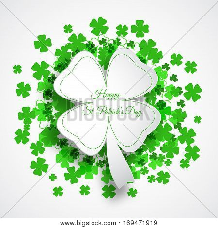 Vector Happy St. Patrick's Day poster on the white background with green leaf of clover shape cut from paper text and clover leaves arranged in a circle.