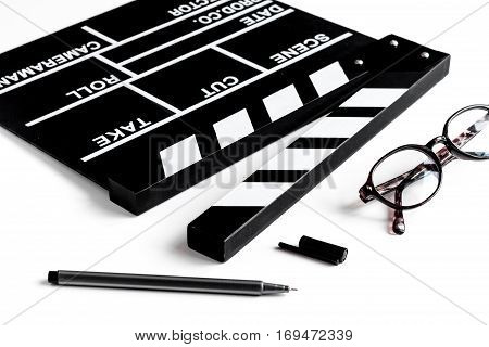 Screenwriter desktop with movie clapper board on white background