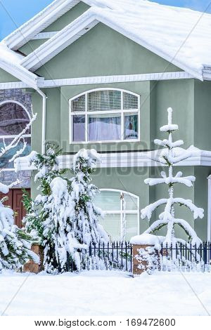 A perfect neighborhood. Fragment of a nice house in suburb at snow winter in the north America.