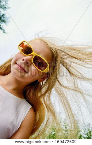 Laughing girl enjoys her childhood. Happy childhood.
