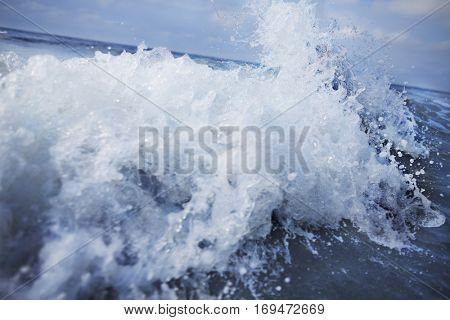 Splashing wave coming into shore