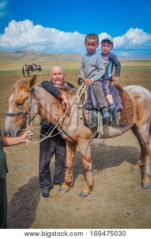 Two Boys On Horseback In Kyrgyzstan