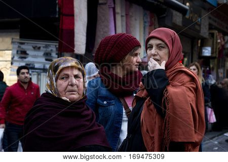 ISTANBUL TURKEY - DECEMBER 28 2015: Women wearing islamic headscarf of various ages in the streets of Istanbul