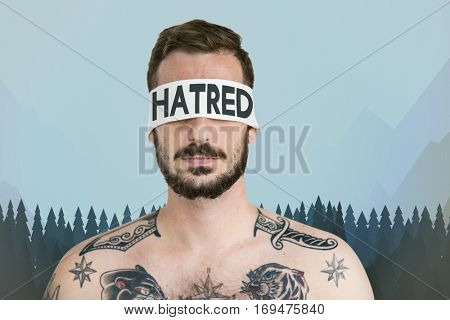 Adult Tattooed Man Blind Hatred Concept