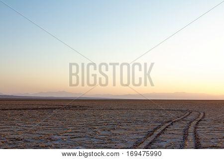 Path on Namak salt lake at Sunset in Maranjab desert near Kashan Iran Namak Lake (Daryacheh-ye Namak) (Persian for Salt Lake) is a salt lake in Iran. It is located approximately 100 km (62 mi) east of the City of Qom and 60 km (37 mi) of Kashan