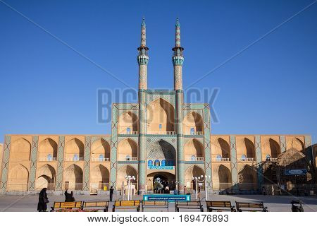 YAZD IRAN - AUGUST 17 2016: Amir Chakhmaq complex in summer. It is a mosque located on a square of the same name The Amir Chakhmaq Complex is a prominent structure in Yazd Iran noted for its symmetrical sunken alcoves.