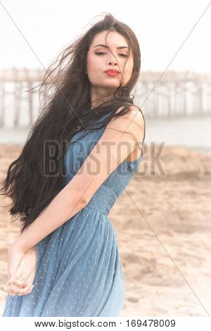 Beautiful Brunette Lady at the beach on a foggy day.