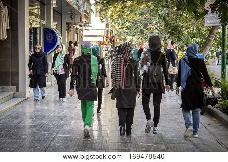ISFAHAN IRAN - AUGUST 20 2016: Women wearing the islamic scarf walking in the streets of Isfahan Iran