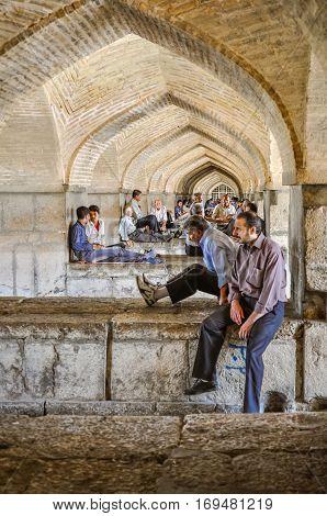 Men Below Arches In Iran