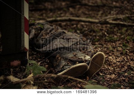 Body Of A Dead Person Lying In Forest Detritus