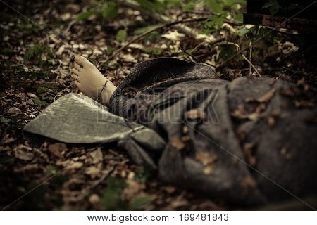 Corpse Of Murder Victim Lying In Forest