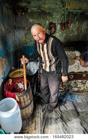 Man With Barrel In Kyrgyzstan