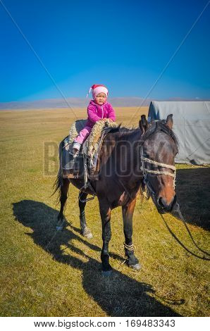 Child In Pink In Kyrgyzstan