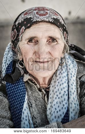 Woman With Humble Eyes In Tajikistan