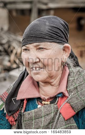 Woman With Black Headcloth In Himachal Pradesh