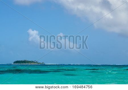 SAN ANDRES COLOMBIA - JANUARY 8 2015: A view of an island far in the distance from the coast of San Andres Colombia.
