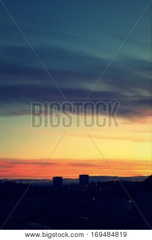 Beautiful evening sky with sunset over a town