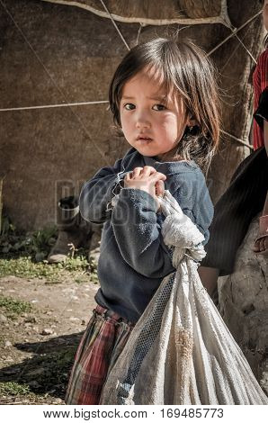 Girl With Sad Face In Kyrgyzstan