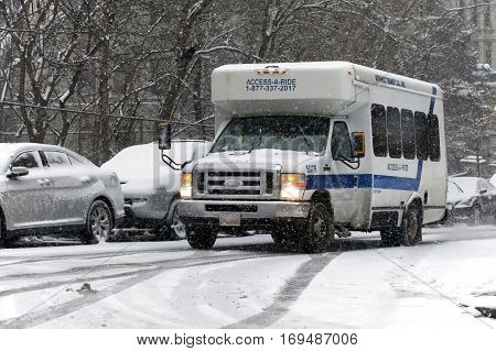 BRONX NEW YORK - JANUARY 7: Access A Ride van during snow storm. Taken January 7 2017 in New York.