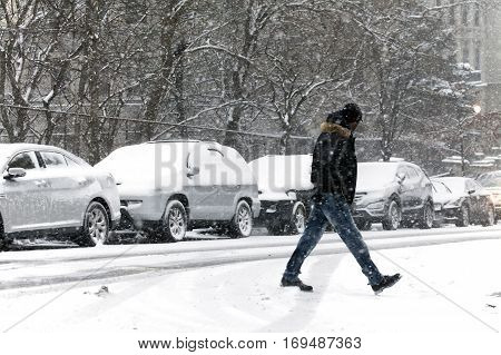 BRONX NEW YORK - JANUARY 7: Man walking in snow storm. Taken January 7 2017 in New York.