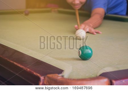 Young Person Playing Snooker - Action on a Billiards table