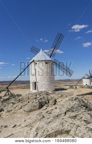 Windmill, White wind mills for grinding wheat. Town of Consuegra in the province of Toledo, Spain