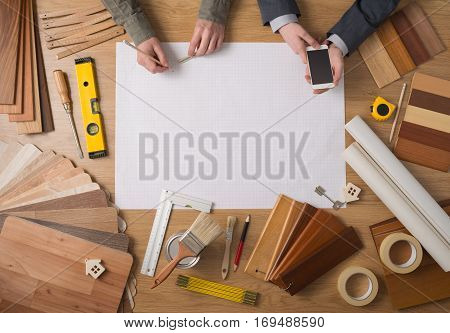 Businessman And Construction Engineer Working At Desk