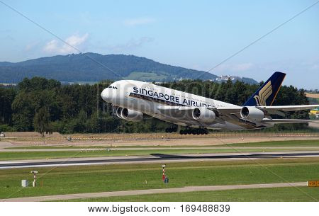 ZURICH - July 30: Singapore Airlines A-380 taking off at Terminal A of Zurich Airport on July 30, 2016 in Zurich, Switzerland. Zurich airport is home port for Swiss Air and one of the european hubs.