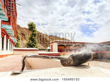 Pot with smoking incense at a buddhist monastery in Ladakh, Kashmir, India
