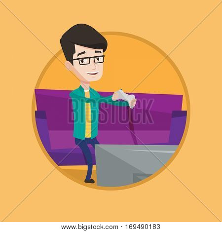 Happy caucasian man playing video game on the television. Excited young man with game console in hands playing video game at home. Vector flat design illustration in the circle isolated on background.