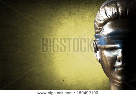 Lady of justice or Themis against golden background