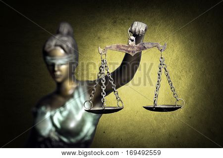 Lady Justice on golden grunge background (Concept of justice)