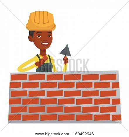 African-american bicklayer working with a spatula and a brick. Young confident bricklayer in uniform and hard hat. Bricklayer at work. Vector flat design illustration isolated on white background.