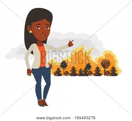 African woman pointing at forest in fire. Frustrated woman standing on the background of forest fire. Concept of environmental destruction. Vector flat design illustration isolated on white background