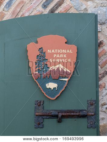 San Antonio United States: January 21st 2017: A National Park Service sign on a green door at the Missions National Monument