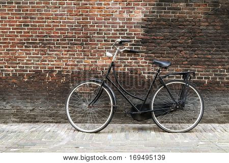 Vintage bike against grunge old brick wall