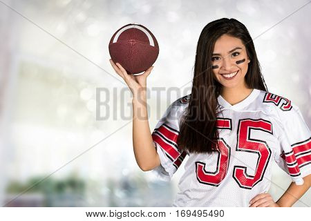 Young woman cheering for her favorite football team