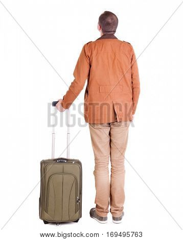 Back view of stylishly dressed man in a brown jackett with  suitcase looking up.   Standing young guy in jeans and  jacket. backside view of person.  Isolated over white background.