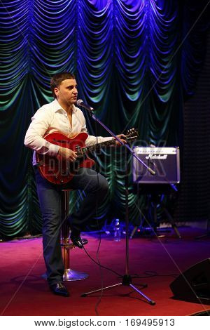 MOSCOW - APR, 16, 2016: Yugorsky Alexander singing and playing guitar in jazz club Kino