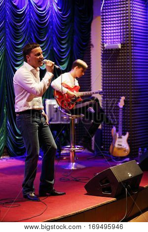 MOSCOW - APR, 16, 2016: Yugorsky Alexander sings in jazz club Kino