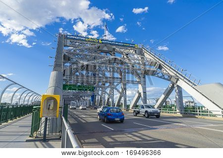 Brisbane, Australia - September 23, 2016: View of traffic on iconic Story Bridge, the longest cantilever bridge in Australia, with guide rails for the bridge walks.
