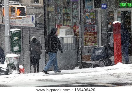 BRONX NEW YORK - JANUARY 7: People walk in snow storm. Taken January 7 2017 in New York.