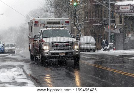 BRONX NEW YORK -JANUARY 7: Ambulance drives through street in snow storm. Taken January 7 2017 in New York.