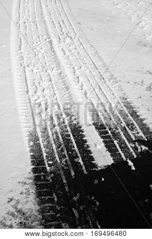 Road roadway with snow and ice car tracks slippery