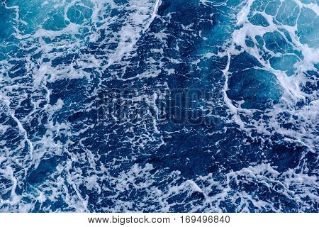 Background, blue turbulent waves of the sea