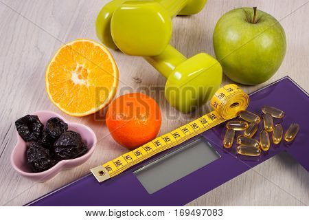 Digital Scale With Tape Measure, Dumbbells, Tablets, Fruits, Slimming Concept
