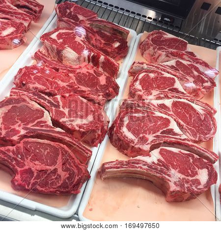 2 inch bone-in Rib Eye steaks (cowboy steaks) displayed at the meat market